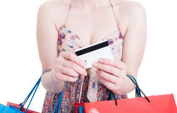 Close-up of debit card in female shopaholic hands Royalty Free Stock Photos