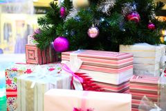 Close up of Decorated Christmas tree and boxes Royalty Free Stock Photography