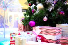 Close up of Decorated Christmas tree and boxes Stock Photography
