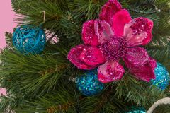 Decorated Christmas Tree with prominent Pink Flower Decoration. Close-up of a Decorated Christmas Tree with prominent Pink Flower Decoration Stock Photography