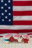 Close-up of decorated cupcakes and cookies arranged on table Stock Photo