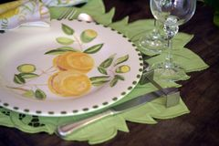 Close-up of decorated for special event table. With colorful crockery dish Royalty Free Stock Photos
