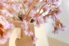 Close up a decoration of Tiny Lilac flowers in vase Stock Images