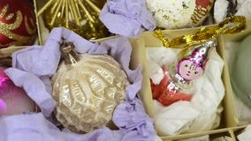 Close up decoration toys. Close up of vintage Christmas tree toys, sliding camera motion stock footage