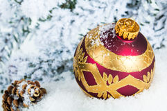Close up of decorative Christmas ball on the snow Stock Images