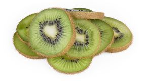 Pile of sliced kiwis with brown skin. Fuzzy kiwifruit. Actinidia deliciosa. Close-up of decorative green sweet-sour kiwifruits on a white background royalty free stock photography