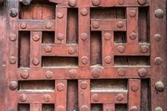 Old wooden door with decorative pattern in India. Close up decorative pattern on old wooden door in India Stock Image
