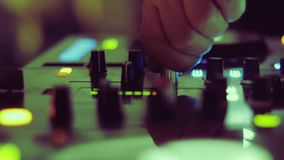Close up of dee jay hands mixing in nightclub stock footage