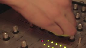 Close-up of deejay's hands playing cool music and pushing mixer buttons. Party. Stock footage stock video