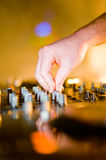 Close-up of deejays hand Royalty Free Stock Images