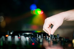 Close-up of deejays hand and turntable Royalty Free Stock Photography