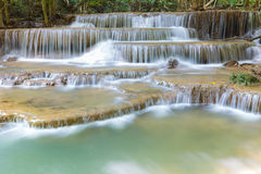 Close up deep forest water fall during spring in national park of Thailand Royalty Free Stock Images