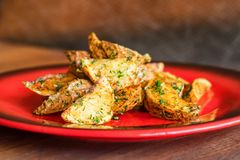 Baked potato wedges with dill and spices close stock photo
