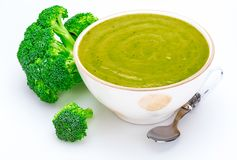 Close-up of Delicious broccoli cream in a bowl. Foreground. Includes fresh broccoli. Isolated on white background royalty free stock photography