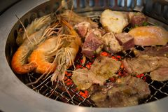 Close up of delicious grilled seafood platter. Grill the seafood. Fresh beef steak. meat Stock Image