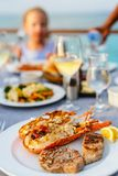 Grilled seafood platter. Close up of delicious grilled seafood platter served with white wine for dinner Stock Photography