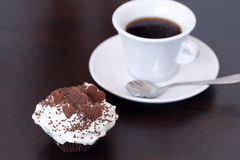 Close up of delicious holiday homemade chocolate chip cupcake with coffee tea cup Stock Photo