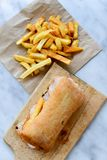 French fries and Ciabatta bread sandwich royalty free stock photography