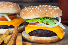 Close up of delicious homemade cheeseburger. Royalty Free Stock Images