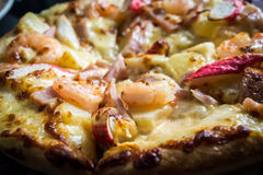 Close up delicious italian seafood pizza with shrimp cheese praw Royalty Free Stock Photo