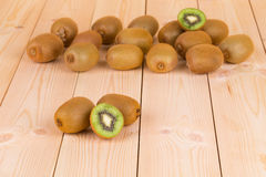 Close up of delicious kiwi on wood table. Stock Images