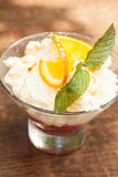Close up on a delicious lemon sorbet with mint leaf garnish Royalty Free Stock Photo