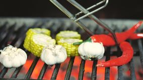 Close up delicious Mexican corn barbecue on cob grill over glowing coals. Ready to eat. Street food appetizing grilled. Corn on the barbecue grill. 4k stock video