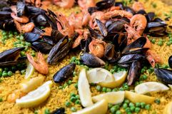 Close-up of delicious paella. With shrimp, clams, peas and rice Royalty Free Stock Photo