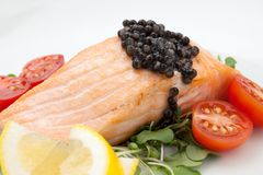 Fried Salmon With Black Caviar Royalty Free Stock Images