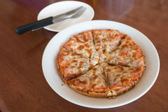 Close-up,Delicious Pizza with Ham, Bacon and sausages. Stock Image