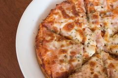 Close-up,Delicious Pizza with Ham, Bacon and sausages. Royalty Free Stock Image