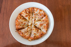 Close-up,Delicious Pizza with Ham, Bacon and sausages. Royalty Free Stock Photos