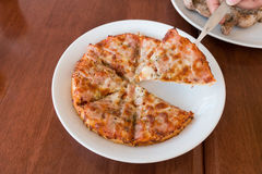 Close-up,Delicious Pizza with Ham, Bacon and sausages. Royalty Free Stock Images