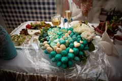 Wedding bouquet made of sweets on table stock images