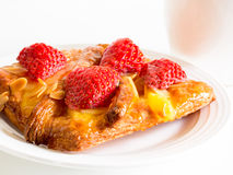 Close up delicius strawberry danish pastry and white tea cup Stock Photography