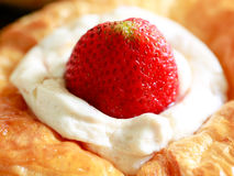 Close up delicius strawberry danish pastry. On the wood table Royalty Free Stock Images