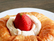 Close up delicius strawberry danish pastry. On the wood table Stock Image
