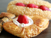 Close up delicius strawberry danish pastry. On the wood table Royalty Free Stock Photo