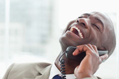 Close up of a delighted businessman on the phone Royalty Free Stock Image
