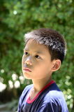 Close up Demeanor of Thai Boy. Close up Demeanor of Thailand, Asian begin as  wild age boy. (10 - 12 years old Royalty Free Stock Photos