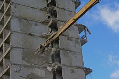 Close up of demolition crane breaking down an old apartment building. Demolition crane breeaking down the skeleton of an old apartment building, Rabot, Ghent Royalty Free Stock Image