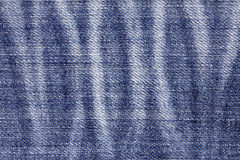 Close up the denim bright  blue jeans surface with rag patten te Royalty Free Stock Photography