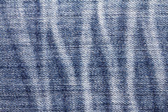 Close up the denim bright  blue jeans surface with rag patten te Royalty Free Stock Photo