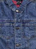 Close-up of denim cloth. Close-up of a baby jean jacket Royalty Free Stock Image