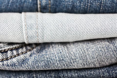 Close up of denim clothes or jeans pile Stock Photos
