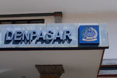 Close up of the Denpasar text and Imigrasi Immigration Logo in Bali. Close up picture of the text Denpasar and the Imigrasi Immigration Logo at the Immigration stock photos