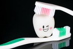 Close up; Dental tools and smile teeth mode. Close up; Dental tools and smile teeth model on black background stock image