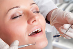 Close-Up of a Dentist at Work Stock Images