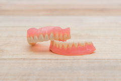 Close-up Dentures on wooden table Royalty Free Stock Photos