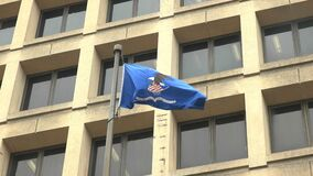 Close up of the department of justice flag on the fbi building in d.c.
